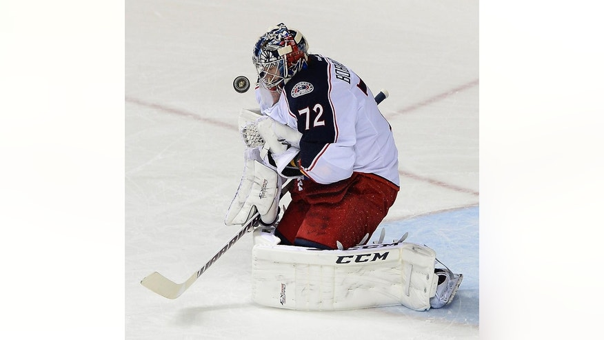 Columbus Blue Jackets goalie Sergei Bobrovsky (72), of Russia, blocks a shot in the first period of an NHL hockey game against the Nashville Predators, Saturday, March 8, 2014, in Nashville, Tenn. (AP Photo/Mark Zaleski)