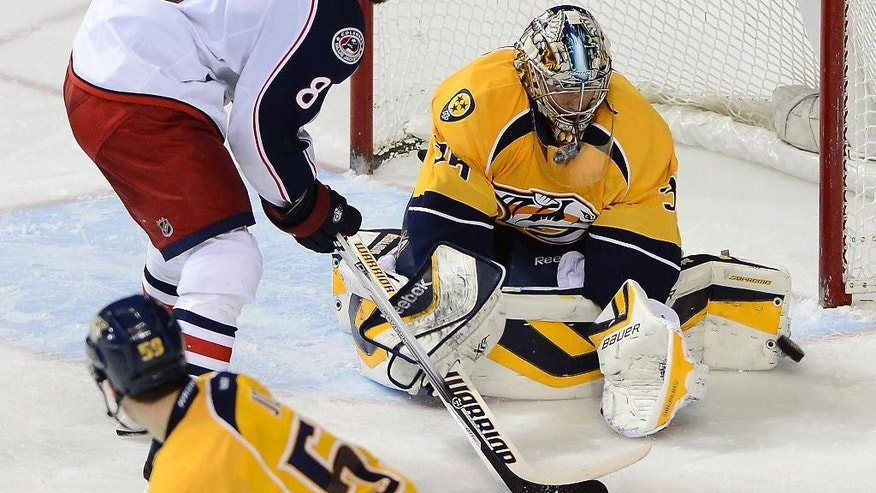 Columbus Blue Jackets forward Nathan Horton (8) has his shot blocked by Nashville Predators goalie Pekka Rinne (35), of Finland, in the second period of an NHL hockey game on Saturday, March 8, 2014, in Nashville, Tenn. (AP Photo/Mark Zaleski)