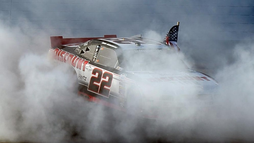 Brad Keselowski does a burnout after winning the NASCAR Nationwide Series auto race Saturday, March 8, 2014, in Las Vegas. (AP Photo/Isaac Brekken)