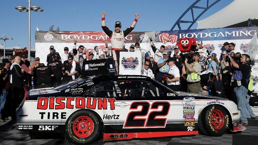Brad Keselowski celebrates in Victory Lane after winning the NASCAR Nationwide Series auto race Saturday, March 8, 2014, in Las Vegas. (AP Photo/Isaac Brekken)