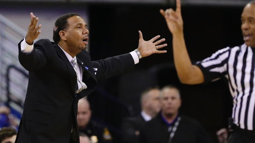 Providence coach Ed Cooley disputes a foul call against his team in the first half on an NCAA college basketball game against Creighton in Omaha, Neb., Saturday, March 8, 2014. (AP Photo/Nati Harnik)