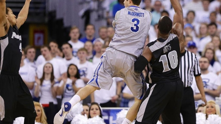 Creighton's Doug McDermott (3) passes the ball against the defense of Providence's Kadeem Batts (10) and Providence's Josh Fortune, left, in the first half on an NCAA college basketball game in Omaha, Neb., Saturday, March 8, 2014. (AP Photo/Nati Harnik)