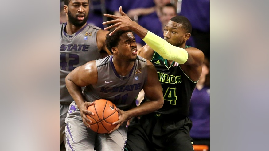 Kansas State's Nino Williams is pressured by Baylor's Cory Jefferson, right, during the first half of an NCAA college basketball game Saturday, March 8, 2014, in Manhattan, Kan. (AP Photo/Charlie Riedel)