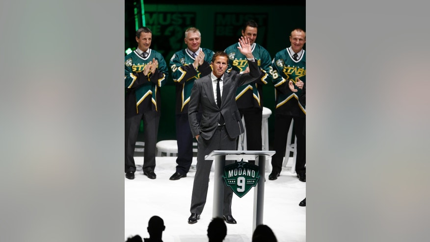 Former Dallas Star Mike Modano waves to the crowd during his jersey retirement ceremony before the NHL hockey game between the Stars and the Minnesota Wild on Saturday, March 8, 2014, in Dallas. (AP Photo/The Dallas Morning News, Nathan Hunsinger) MANDATORY CREDIT; MAGS OUT; TV OUT; INTERNET USE BY AP MEMBERS ONLY; NO SALES