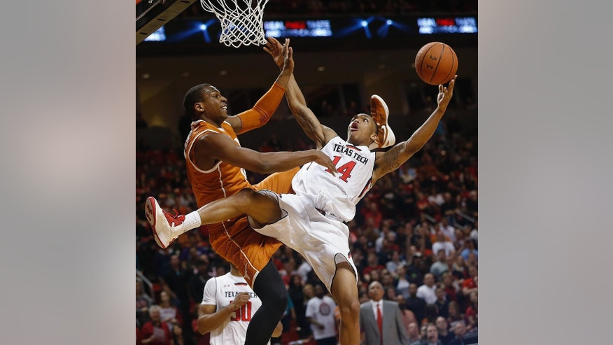 Texas Tech's Robert Turner is fouled by Texas' Jonathan Holmes during an NCAA college basketball game in Lubbock, Texas, Saturday, March 8, 2014. (AP Photo/Lubbock Avalanche-Journal, Zach Long) LOCAL TV OUT