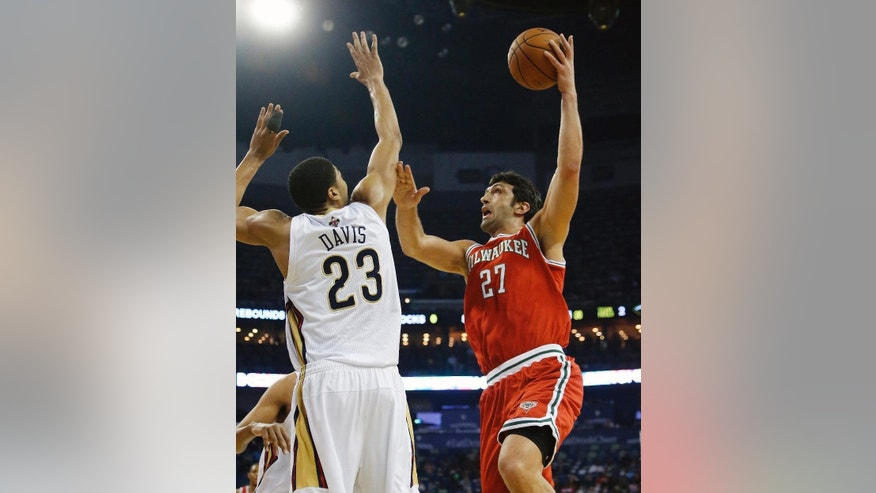 Milwaukee Bucks center Zaza Pachulia (27) shoots over New Orleans Pelicans forward Anthony Davis (23) during the first half of an NBA basketball game in New Orleans, Friday, March 7, 2014. (AP Photo/Bill Haber)