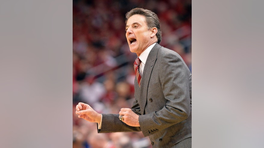 Louisville head coach Rick Pitino shouts instructions to his team during the first half of an NCAA college basketball game against Connecticut, Saturday, March 8, 2014, in Louisville, Ky. (AP Photo/Timothy D. Easley)