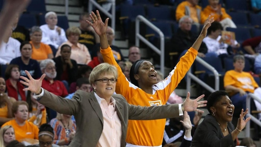 Tennessee coach Holly Warlick, left, and others react during the first half of an NCAA college basketball game against Texas A&M in the semifinals of the Southeastern Conference women's basketball tournament, Saturday, March 8, 2014, in Duluth, Ga. (AP Photo/Jason Getz)