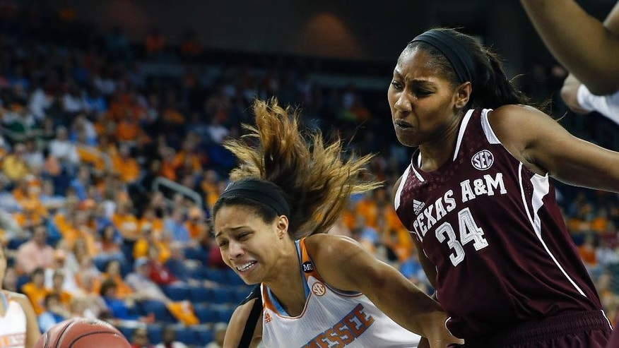 Tennessee center Isabelle Harrison (20) and Texas A&M center Karla Gilbert (34) chase a loose ball in the first half of an NCAA college basketball game in the semifinals of the Southeastern Conference women's basketball tournament Saturday, March 8, 2014, in Duluth, Ga. (AP Photo/John Bazemore)