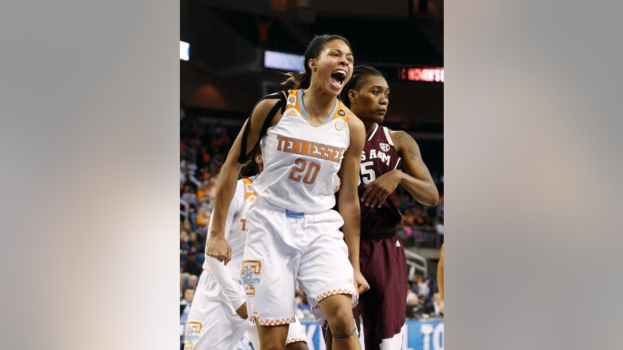 Tennessee center Isabelle Harrison (20) reacts in front of Texas A&M forward Achiri Ade (35) after being fouled in the first half of an NCAA college basketball game in the semifinals of the Southeastern Conference women's basketball tournament Saturday, March 8, 2014, in Duluth, Ga. (AP Photo/John Bazemore)