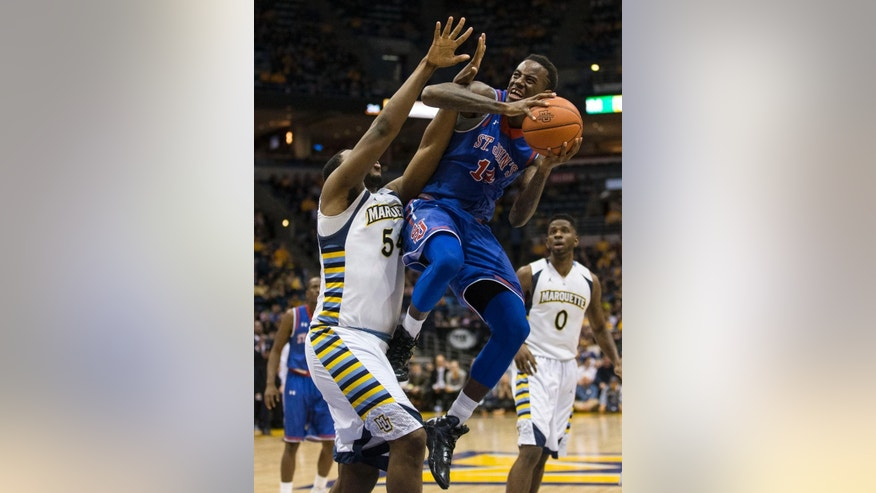 Marquette's Davante Gardner, left, defends as St. John's JaKarr Sampson shoots during the second half of an NCAA college basketball game Saturday, March 8, 2014, in Milwaukee. (AP Photo/Tom Lynn)