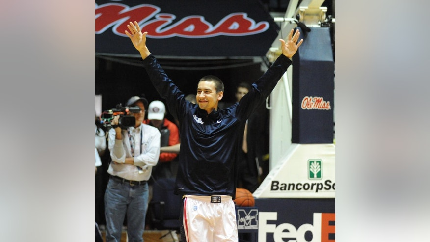 Mississippi's Marshall Henderson (22) is recognized on senior day before an NCAA college basketball game agianst Vanderbilt in Oxford, Miss., Saturday, March 8, 2014. (AP Photo/Oxford Eagle, Bruce Newman)  MAGS OUT, NO SALES, MANDATORY CREDIT
