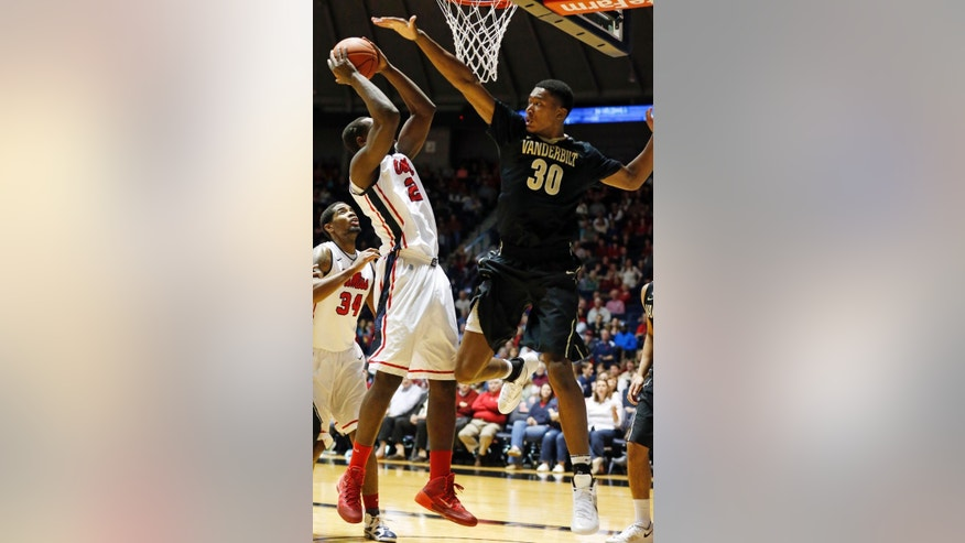 Mississippi center Dwight Coleby (23) is denied a shot at the basket by Vanderbilt forward Damian Jones (30) in the first half of an NCAA college basketball game in Oxford, Miss., Saturday, March 8, 2014. (AP Photo/Rogelio V. Solis)