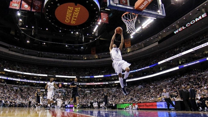 Villanova's Josh Hart goes up for a dunk during the first half of an NCAA college basketball game against Georgetown, Saturday, March 8, 2014, in Philadelphia. (AP Photo/Matt Slocum)
