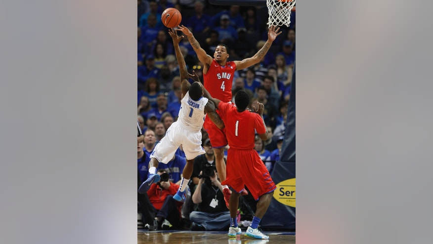 SMU guards Keith Frazier (4) and Ryan Manuel (1) block a shot by Memphis guard Joe Jackson, left, in the first half of an NCAA college basketball game Saturday, March 8, 2014, in Memphis, Tenn. (AP Photo/Lance Murphey)