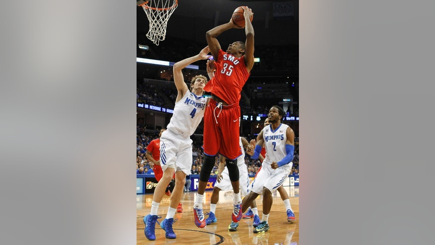 SMU center Yanick Moreira (35) shoots against Memphis forwards Austin Nichols (4) and Shaq Goodwin (2) in the first half of an NCAA college basketball game Saturday, March 8, 2014, in Memphis, Tenn. (AP Photo/Lance Murphey)