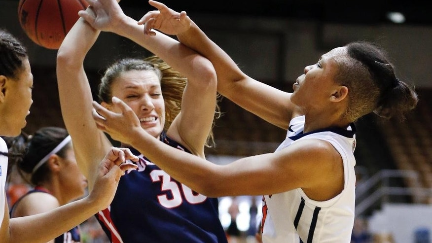 Belmont center Blair Bryce (30) and Tennessee-Martin guard Shai Warfield-Cross, right, fight for a rebound in the first half of an NCAA college basketball game in the championship of the Ohio Valley Conference women's basketball tournament on Saturday, March 8, 2014, in Nashville, Tenn. (AP Photo/Mark Humphrey)