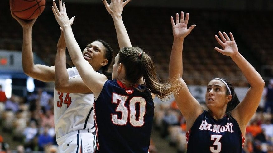 Tennessee Martin forward Ashia Jones (34) shoots as she is defended by Belmont's Blair Bryce (30) and Frankie Joubran (3) in the first half of an NCAA college basketball game in the championship of the Ohio Valley Conference women's basketball tournament on Saturday, March 8, 2014, in Nashville, Tenn. (AP Photo/Mark Humphrey)