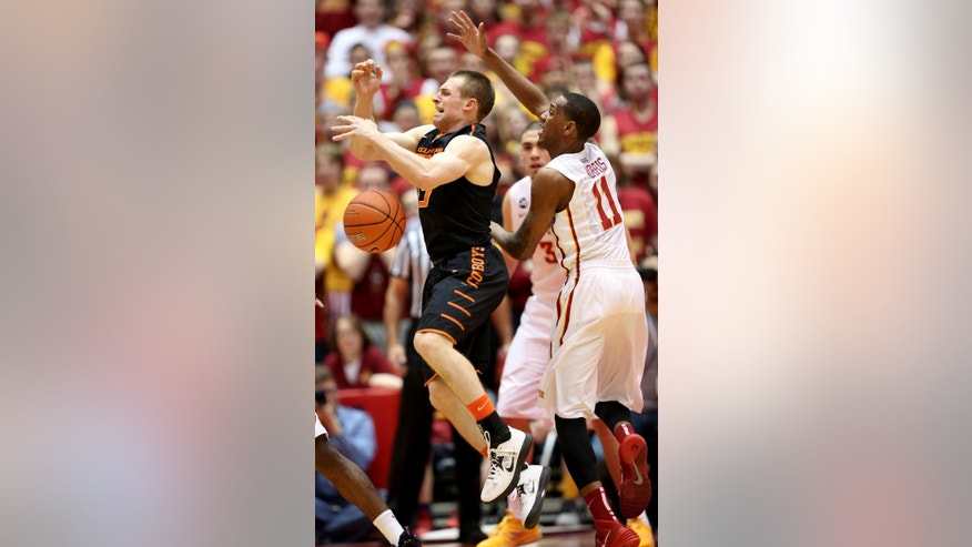 Oklahoma State guard Phil Forte III, left, loses the ball as he is defended by Iowa State guard Monte Morris during the first half of an NCAA college basketball game in Ames, Iowa, Saturday, March 8, 2014. (AP Photo/Justin Hayworth)