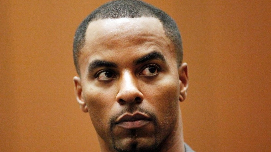 FILE - This feb. 20, 2014 file photo shows former NFL safety Darren Sharper appearing  in Los Angeles Superior Court in Los Angeles. Sharper will remain jailed in Los Angeles, despite an arrest warrant issued for him in New Orleans, a judge ruled Friday March 7, 2014.  (AP Photo/Los Angeles Times, Bob Chamberlin, Pool)