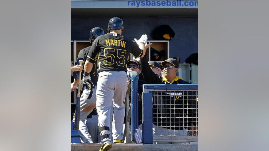 Pittsburgh Pirates Russell Martin is greeted at the dugout after hitting a three-run homer off  Tampa Bay Rays relief pitcher Grant Balfour in the fourth inning of a exhibition baseball game in Port Charlotte, Fla., Saturday, March 8, 2014. (AP Photo/Gerald Herbert)