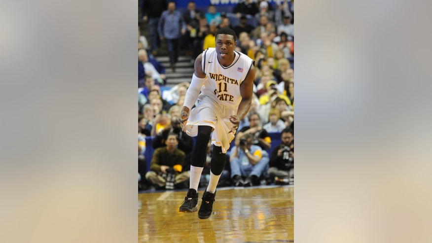 Wichita State's Cleanthony Early (11) celebrates a basket against Missouri State in the first half of an NCAA college basketball game in the semifinals of the Missouri Valley Conference men's tournament, Saturday, March 8, 2014, in St. Louis. (AP Photo/Bill Boyce)