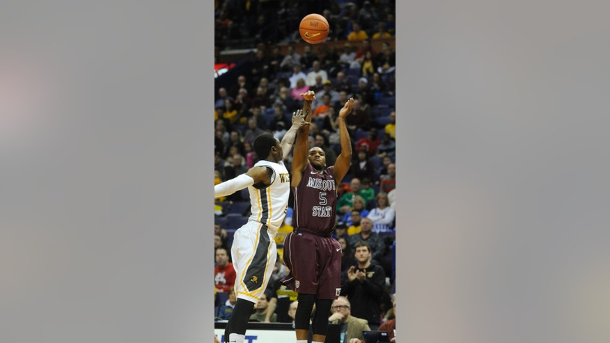 Missouri State's Jarmar Gulley (5) shoots over Wichita State's Cleanthony Early, left, in the first half of an NCAA college basketball game in the semifinals of the Missouri Valley Conference men's tournament, Saturday, March 8, 2014, in St. Louis. (AP Photo/Bill Boyce)