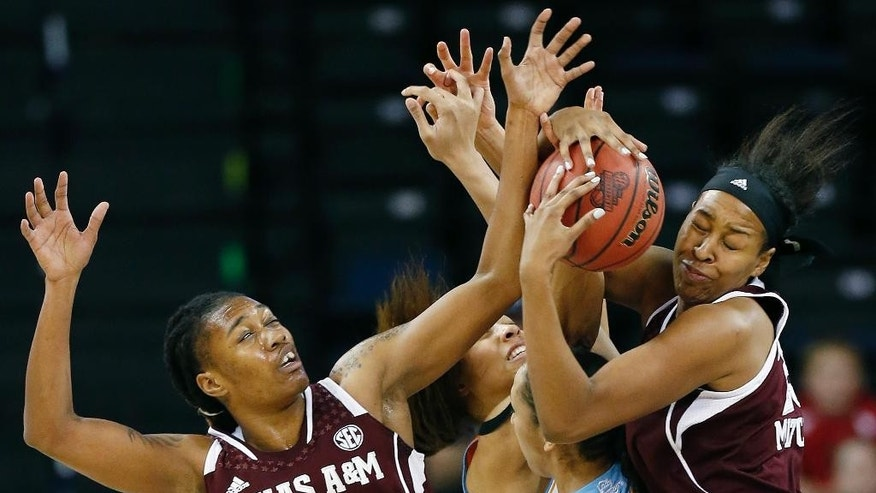 Texas A&M forward Achiri Ade (35) and center Rachel Mitchell, right, fight for a rebound against Tennessee during the first half of an NCAA college basketball game in the semifinals of the Southeastern Conference women's basketball tournament Saturday, March 8, 2014, in Duluth, Ga. (AP Photo/John Bazemore)