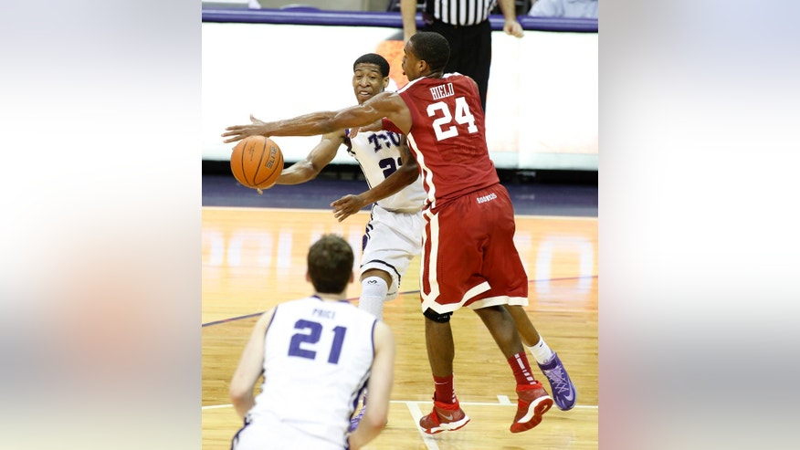 TCU guard Jarvis Ray (22) looks to pass to guard Hudson Price (21) as Oklahoma guard Buddy Hield (24) defends in the first half of an NCAA college basketball game Saturday, March 8, 2014, in Fort Worth, Texas. (AP Photo/Sharon Ellman)