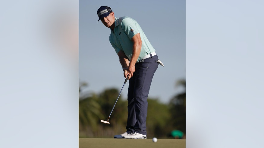Hunter Mahan hits on the 14th green during the third round of the Cadillac Championship golf tournament Saturday, March 8, 2014, in Doral, Fla. (AP Photo/Lynne Sladky)