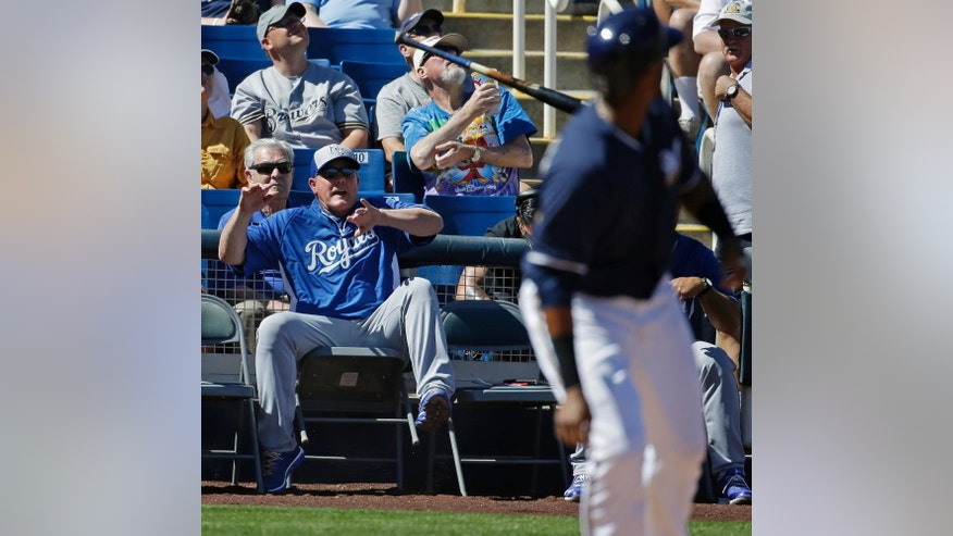 Kansas City Royals manager Ned Yost reacts as Milwaukee Brewers' Martin Maldonado looses his bat during the first inning of an exhibition spring training baseball game Saturday, March 8, 2014, in Phoenix. (AP Photo/Morry Gash)