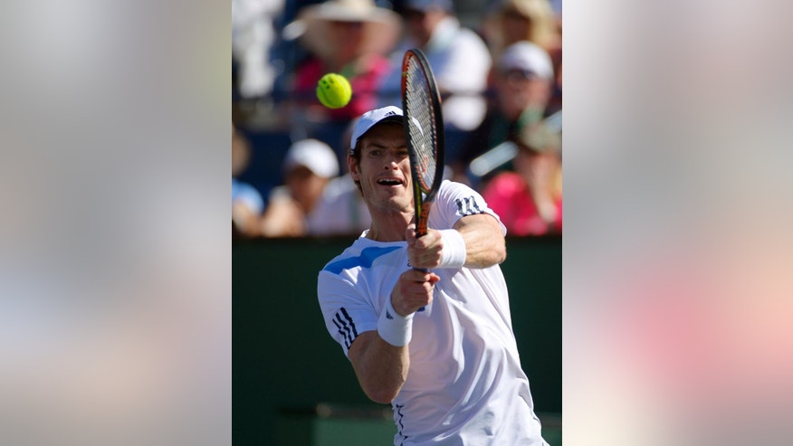 Andy Murray, of Great Britain, returns a shot to Lukas Rosol, of the Czech Republic, during their match at the BNP Paribas Open tennis tournament, Saturday, March 8, 2014, in Indian Wells, Calif. (AP Photo/Mark J. Terrill)