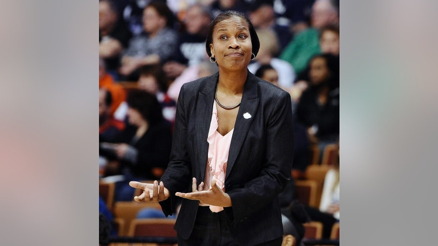 Cincinnati head coach Jamelle Elliot reacts during the first half of an NCAA college basketball game against Connecticut in the quarterfinals of the American Athletic Conference women's basketball tournament, Saturday, March 8, 2014, in Uncasville, Conn. (AP Photo/Jessica Hill)