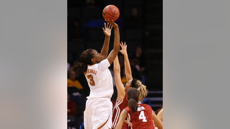 Texas forward Nneka Enemkpali (3) shoots over Oklahoma guard Nicole Kornet (1) in the first half of an NCAA college basketball game in the quarterfinals of the Big 12 Conference women's tournament in Oklahoma City, Saturday, March 8, 2014. (AP Photo/Sue Ogrocki)