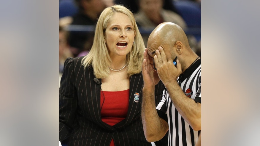 Maryland head coach Brenda Frese, left, shouts to her team as a referee walks past during the first half of an NCAA college basketball game against North Carolina at the Atlantic Coast Conference tournament in Greensboro, N.C., Friday, March 7, 2014. (AP Photo/Chuck Burton)