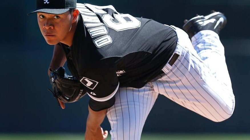 Chicago White Sox pitcher Jose Quintana throws a warmup pitch in the first inning during an exhibition baseball game against the Arizona Diamondbacks in Glendale, Ariz., Saturday, March 8, 2014. (AP Photo/Paul Sancya)