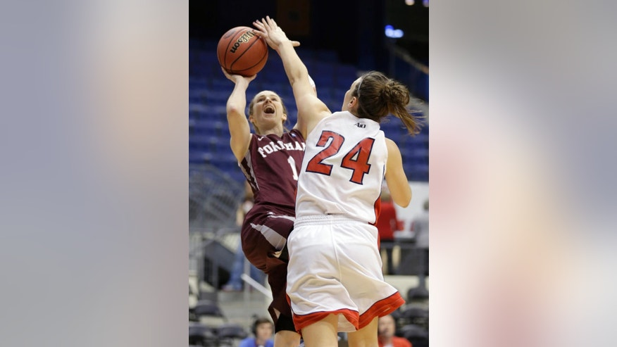 Fordham guard Erin Rooney (1) shoots as Dayton guard Andrea Hoover (24) defends during the first half of the Atlantic 10 Conference college basketball championship game in Richmond, Va., Sunday, March 9, 2014. (AP Photo/Steve Helber)