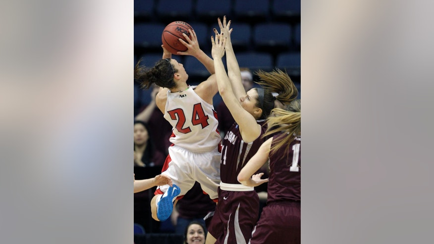 Dayton guard Andrea Hoover (24) shoots over Fordham forward Danielle Padovano during the first half of the Atlantic 10 Conference college basketball championship game in Richmond, Va., Sunday, March 9, 2014. (AP Photo/Steve Helber)