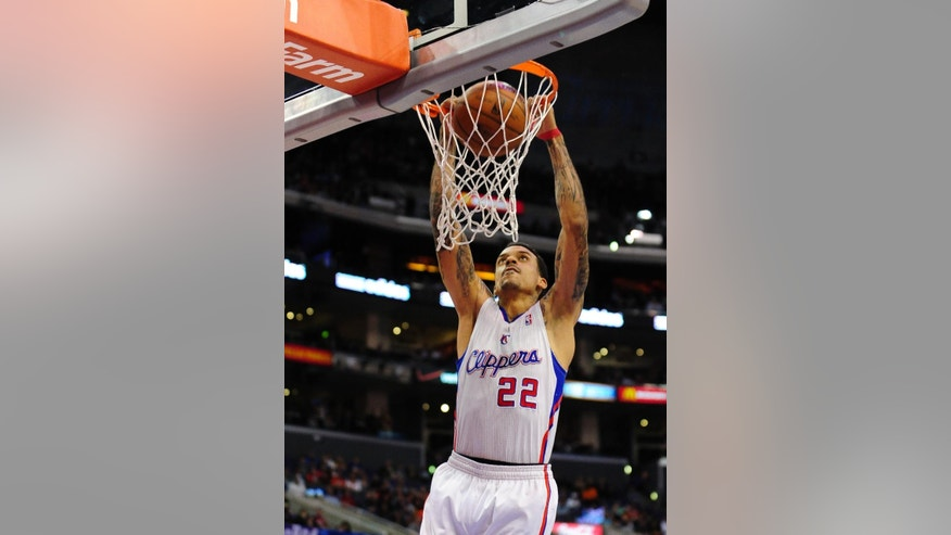 Los Angeles Clippers forward Matt Barnes dunks on a fast break in the first half of an NBA basketball game against the Atlanta Hawks, Saturday, March 8, 2014, in Los Angeles. (AP Photo/Gus Ruelas)