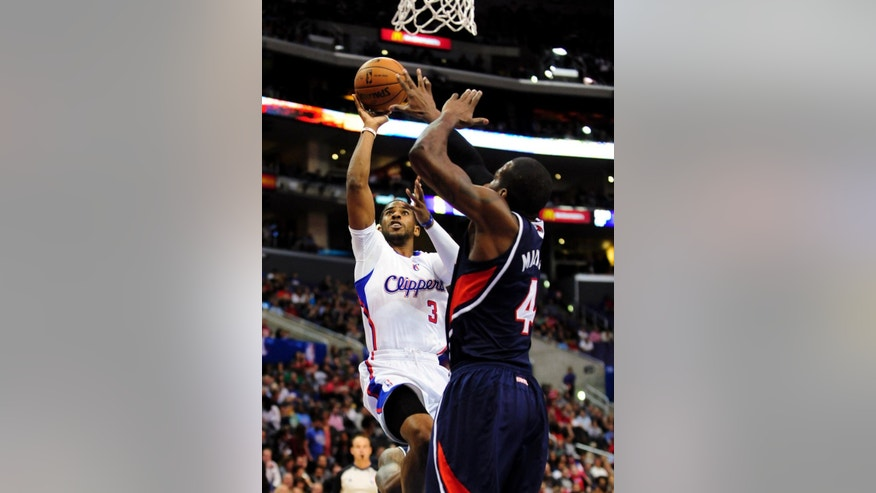 Los Angeles Clippers guard Chris Paul (3) shoots over Atlanta Hawks forward Paul Millsap (4) in the first half of an NBA basketball game, Saturday, March 8, 2014, in Los Angeles. (AP Photo/Gus Ruelas)