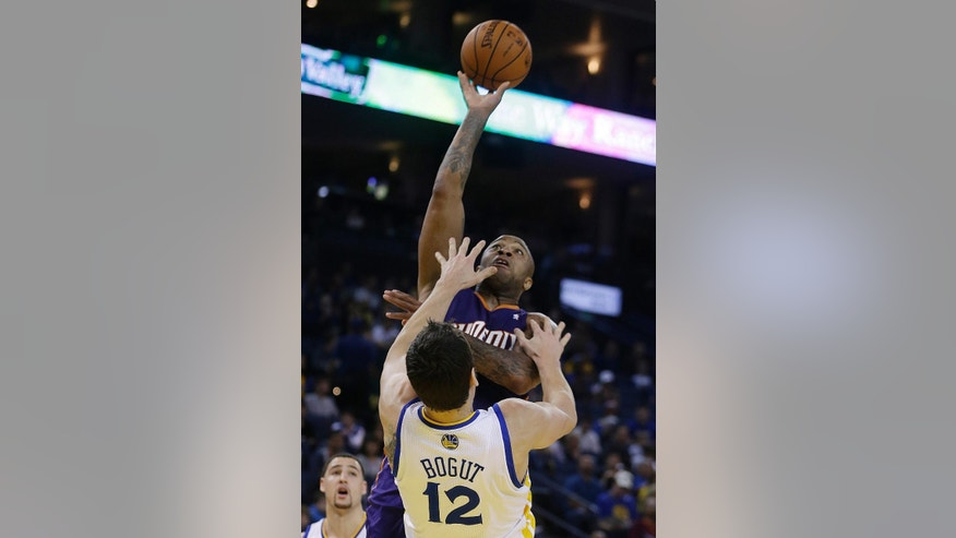Phoenix Suns' P.J. Tucker shoots over Golden State Warriors' Andrew Bogut (12) during the first half of an NBA basketball game Sunday, March 9, 2014, in Oakland, Calif. (AP Photo/Ben Margot)