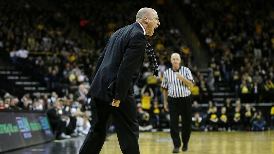 Illinois head coach John Groce reacts to a call against his team during the first half of an NCAA college basketball game against Iowa, Saturday, March 8, 2014, in Iowa City, Iowa. (AP Photo/Charlie Neibergall)