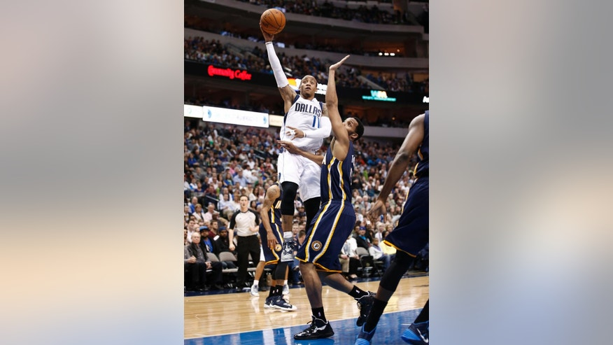 Dallas Mavericks shooting guard Monta Ellis (11) shoots the ball over Indiana Pacers' Evan Turner (12) during the first half of an NBA game, Sunday, Mar. 9, 2014, in Dallas, Texas. (AP Photo/Jim Cowsert)