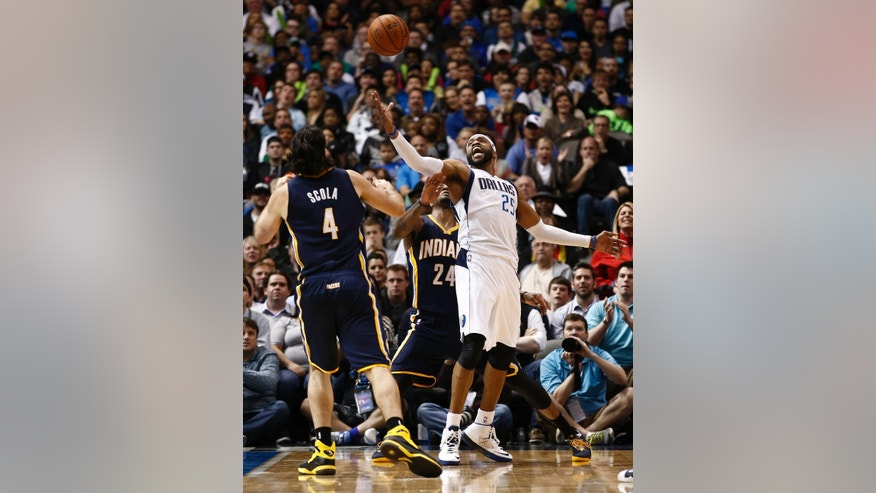 Dallas Mavericks shooting guard Vince Carter (25) battles for a loose ball in front of Indiana Pacers' Paul George (24) and Luis Scola (4), of Argentina during the second half of an NBA game, Sunday, March 9, 2014, in Dallas, Texas. The Dallas Mavericks won 105-94. (AP Photo/Jim Cowsert)
