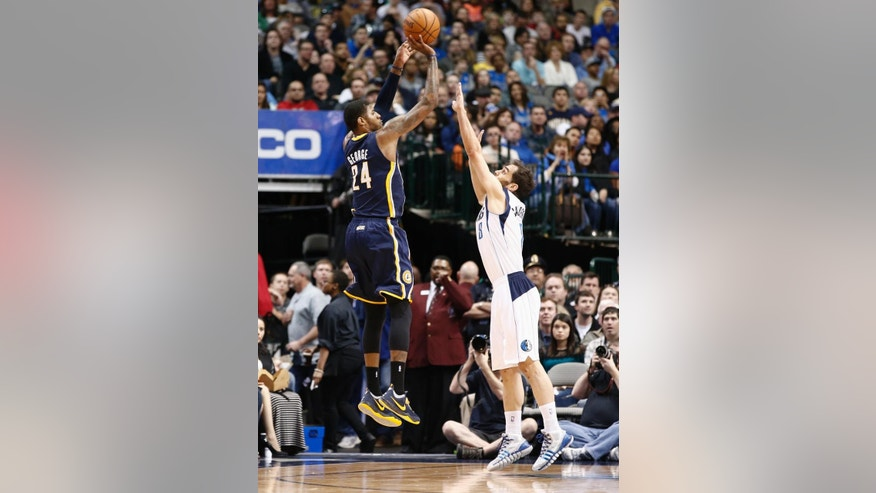 Indiana Pacers small forward Paul George (24) shoots the ball over Dallas Mavericks' Jose Calderon (8) during the first half of an NBA game, Sunday, Mar. 9, 2014, in Dallas, Texas. (AP Photo/Jim Cowsert)