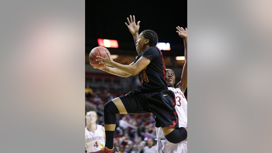 Southern California's Ariya Crook (14) drives past Stanford's Chiney Ogwumike in the first half of an NCAA college basketball game in the Pac-12 women's tournament  Saturday, March 8, 2014, in Seattle. (AP Photo/Elaine Thompson)
