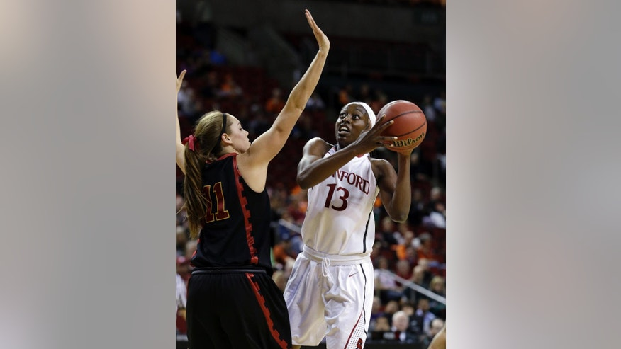 Stanford's Chiney Ogwumike (13) shoots against Southern California's Cassie Harberts in the first half of an NCAA college basketball game in the Pac-12 women's tournament  Saturday, March 8, 2014, in Seattle. (AP Photo/Elaine Thompson)