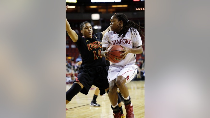 Southern California's Ariya Crook (14) defends as Stanford's Lili Thompson in the first half of an NCAA college basketball game in the Pac-12 women's tournament  Saturday, March 8, 2014, in Seattle. (AP Photo/Elaine Thompson)