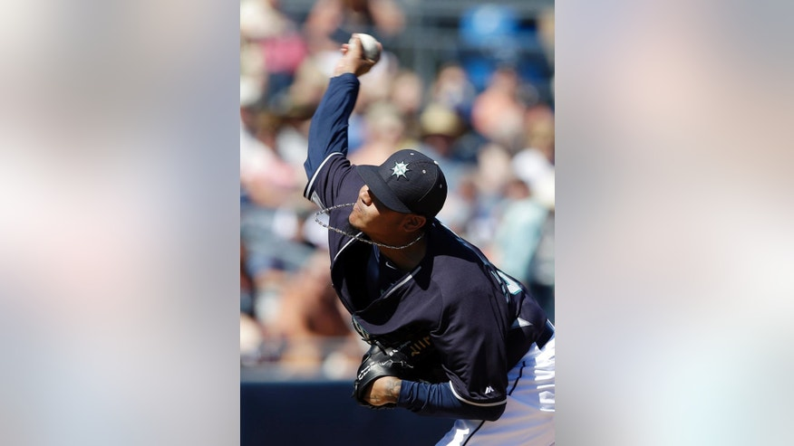 Seattle Mariners starting pitcher Felix Hernandez throws during the first inning of an exhibition spring training baseball game against the Texas Rangers, Sunday, March 9, 2014, in Peoria, Ariz. (AP Photo/Darron Cummings)