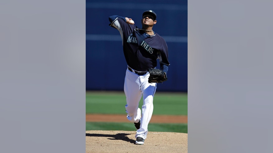 Seattle Mariners starting pitcher Felix Hernandez throws before an exhibition spring training baseball game against the Texas Rangers, Sunday, March 9, 2014, in Peoria, Ariz. (AP Photo/Darron Cummings)